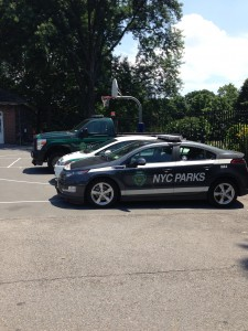 NYC Parks Vehicles Parked on the Basketball Courts of North Meadow Recreation Center in Central Park. July 12th, 2014.